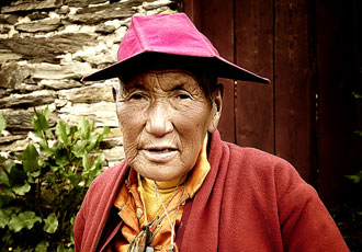 Old Lady On Road to Monastery