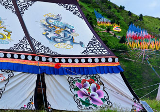 Tibetan Tent with Prayer Flags on Distant Hill